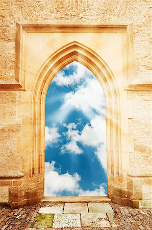 Arch door opening to a beautiful cloudy sky with sun rays Stock Photo - Budget Royalty-Free & Subscription, Code: 400-06747921