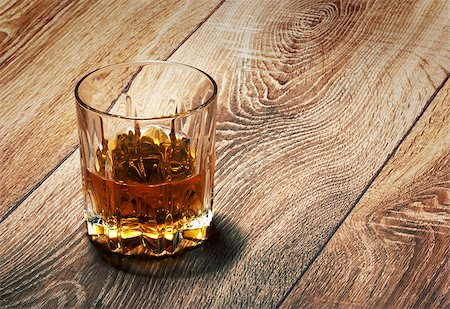 whiskey in glasses on wooden table Stock Photo - Budget Royalty-Free & Subscription, Code: 400-06749183