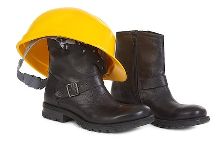 Boots and yellow hard hat over white background, small natural shadow under boots Stock Photo - Budget Royalty-Free & Subscription, Code: 400-06740218