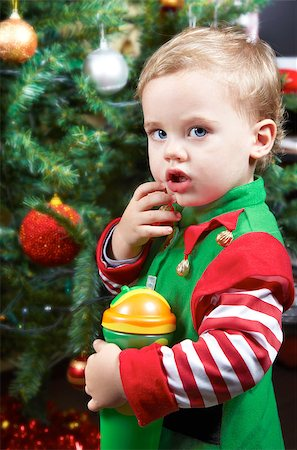 shy baby - One year old baby boy by the Christmas tree, dressed as an elf. Stock Photo - Budget Royalty-Free & Subscription, Code: 400-06742347