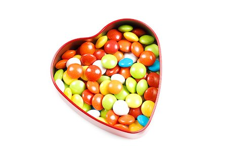 Multicolor candies in heart shape candy box on white background Stock Photo - Budget Royalty-Free & Subscription, Code: 400-06758400