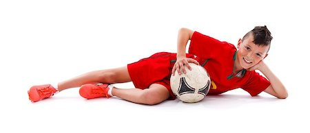 Young boy lying with soccer ball, studio shot Stock Photo - Budget Royalty-Free & Subscription, Code: 400-06759420