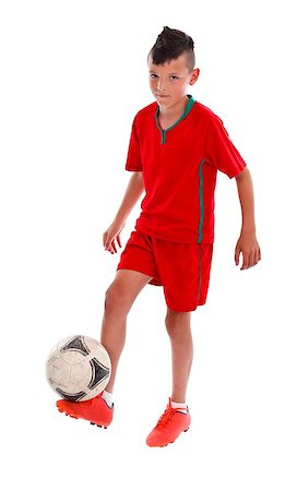 Young kid in red uniform  playing football - studio shot Stock Photo - Budget Royalty-Free & Subscription, Code: 400-06759434