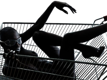 one beautiful black african naked woman sitting inside in a caddy shopping cart in studio isolated on white background Stock Photo - Budget Royalty-Free & Subscription, Code: 400-06750011