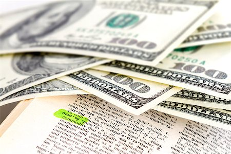 The word money in dictionary with dollars Stock Photo - Budget Royalty-Free & Subscription, Code: 400-06767588