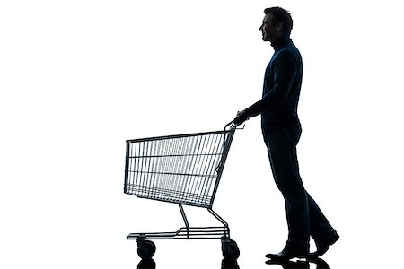 empty shopping cart - one caucasian man with empty shopping cart in silhouette studio isolated on white background Stock Photo - Budget Royalty-Free & Subscription, Code: 400-06768343
