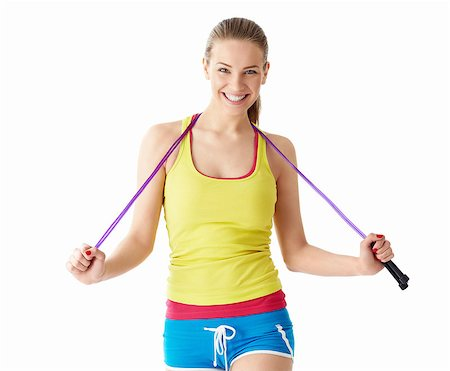 Attractive girl with a skipping rope on a white background Stock Photo - Budget Royalty-Free & Subscription, Code: 400-06769262