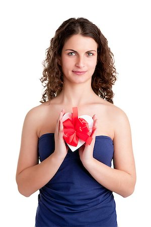 sexy couple chocolate - Woman holds a heart shaped box with her hands, isolated in white Stock Photo - Budget Royalty-Free & Subscription, Code: 400-06769955
