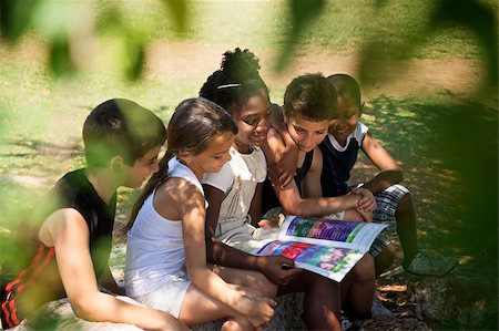 diego_cervo (artist) - Young people and education, two little girls and boys reading book in city park Stock Photo - Budget Royalty-Free & Subscription, Code: 400-06770222
