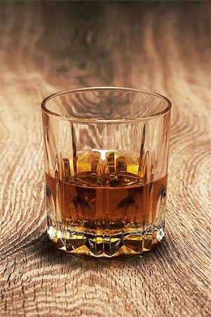 whiskey in glasses on wooden table Stock Photo - Budget Royalty-Free & Subscription, Code: 400-06770580
