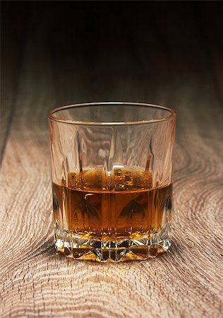 whiskey in glasses on wooden table Stock Photo - Budget Royalty-Free & Subscription, Code: 400-06770581