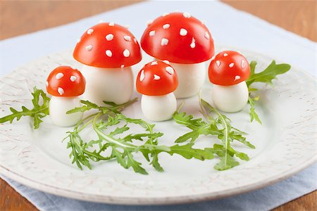 Fly agaric mushrooms made from tomatoes and chicken and quail eggs Stock Photo - Budget Royalty-Free & Subscription, Code: 400-06770875