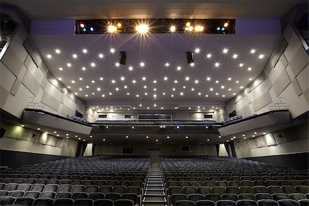 Interior of empty cinema auditorium with lines of chairs. Stock Photo - Budget Royalty-Free & Subscription, Code: 400-06771118