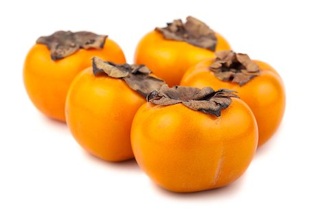 Five persimmon fruits isolated on the white background Stock Photo - Budget Royalty-Free & Subscription, Code: 400-06787873