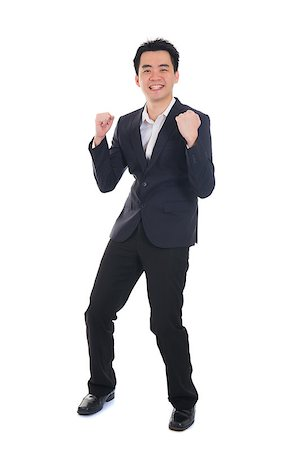 chinese asian business success male jumping in joy with isolated white background Stock Photo - Budget Royalty-Free & Subscription, Code: 400-06787970