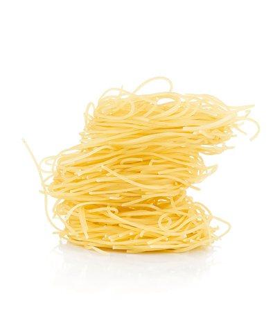Nest pasta. Isolated on white background Stock Photo - Budget Royalty-Free & Subscription, Code: 400-06796246