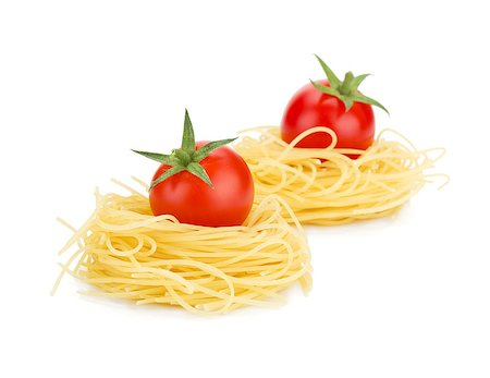 Cherry tomatoes on pasta. Isolated on white background Stock Photo - Budget Royalty-Free & Subscription, Code: 400-06796256