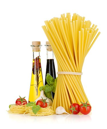 Pasta, tomatoes, basil, olive oil, vinegar, garlic and parmesan cheese. Isolated on white background Stock Photo - Budget Royalty-Free & Subscription, Code: 400-06796258