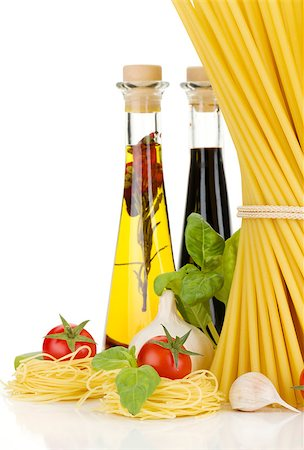 Pasta, tomatoes, basil, olive oil, vinegar, garlic and parmesan cheese. Isolated on white background Stock Photo - Budget Royalty-Free & Subscription, Code: 400-06796259