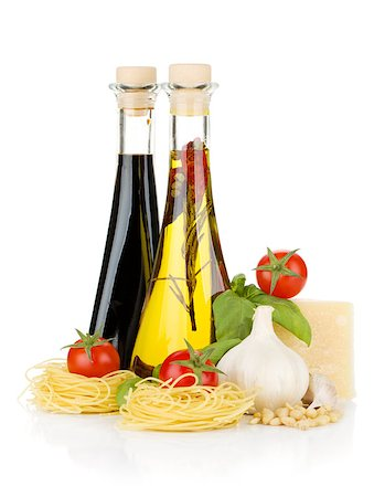 Pasta, tomatoes, basil, olive oil, vinegar, garlic and parmesan cheese. Isolated on white background Stock Photo - Budget Royalty-Free & Subscription, Code: 400-06796266