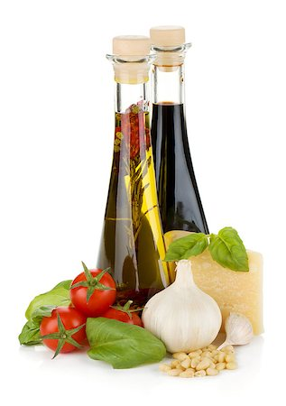 Tomatoes, basil, olive oil, vinegar, garlic and parmesan cheese. Isolated on white background Stock Photo - Budget Royalty-Free & Subscription, Code: 400-06796268