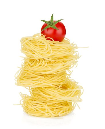 Cherry tomato on pasta. Isolated on white background Stock Photo - Budget Royalty-Free & Subscription, Code: 400-06796269