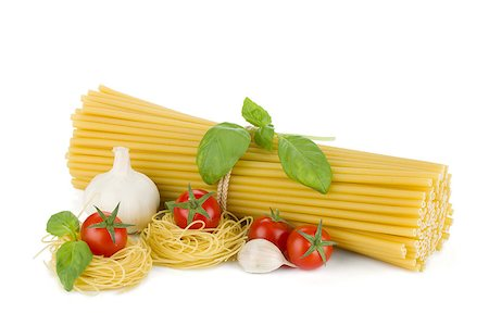 Italian pasta, tomatoes, basil and garlic. Isolated on white background Stock Photo - Budget Royalty-Free & Subscription, Code: 400-06796261