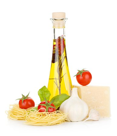 Pasta, tomatoes, basil, olive oil, garlic and parmesan cheese. Isolated on white background Stock Photo - Budget Royalty-Free & Subscription, Code: 400-06796262
