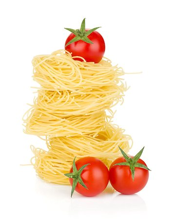 Cherry tomatoes and pasta. Isolated on white background Stock Photo - Budget Royalty-Free & Subscription, Code: 400-06796270
