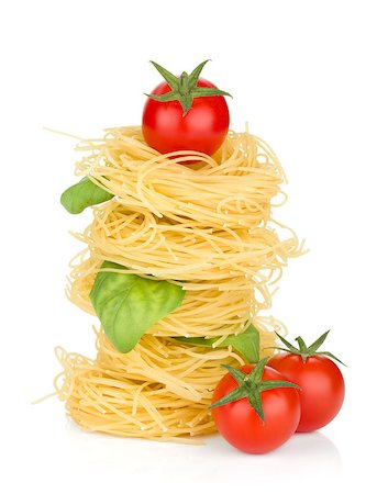 Italian pasta, tomatoes and basil. Isolated on white background Stock Photo - Budget Royalty-Free & Subscription, Code: 400-06796271