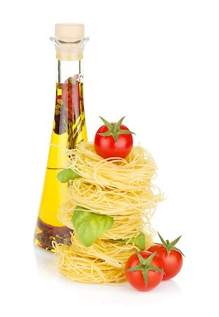 Pasta, tomatoes, basil and olive oil. Isolated on white background Stock Photo - Budget Royalty-Free & Subscription, Code: 400-06796272
