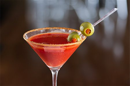pimento - closeup of a bloody mary cocktail garnished with olives isolated on a busy bar top Stock Photo - Budget Royalty-Free & Subscription, Code: 400-06797124