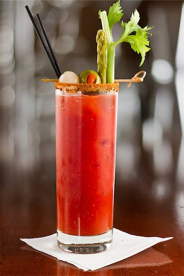 bloody mary cocktail isolated on a busy bar top garnished with onions, olives, asparagus and celery Stock Photo - Royalty-Free, Artist: wollertz, Image code: 400-06797127
