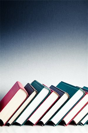 Red, black and green books in a row on white reflective surface Stock Photo - Budget Royalty-Free & Subscription, Code: 400-06799182