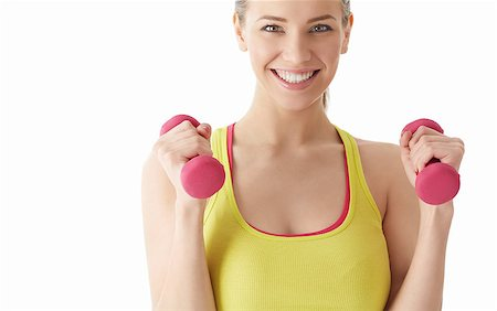 Sports girl with dumbbells on a white background Stock Photo - Budget Royalty-Free & Subscription, Code: 400-06792909