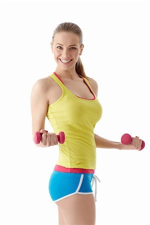 Smiling girl with dumbbells Stock Photo - Budget Royalty-Free & Subscription, Code: 400-06792910