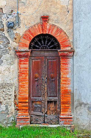 Wooden Ancient Italian Door in Historic Center Stock Photo - Budget Royalty-Free & Subscription, Code: 400-06859768