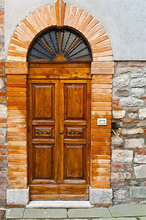 Wooden Ancient Italian Door in Historic Center Stock Photo - Budget Royalty-Free & Subscription, Code: 400-06859772