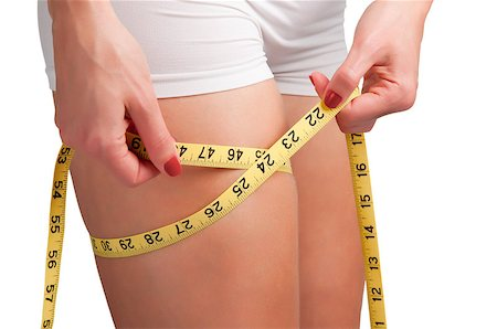 Woman measuring her thigh with a yellow measuring tape Stock Photo - Budget Royalty-Free & Subscription, Code: 400-06853111