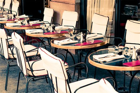 Street view of a coffee terrace with tables and chairs,paris France Stock Photo - Budget Royalty-Free & Subscription, Code: 400-06853474