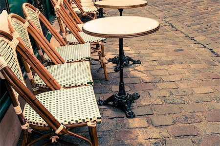 Street view of a coffee terrace with tables and chairs,paris France Stock Photo - Budget Royalty-Free & Subscription, Code: 400-06853473