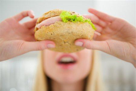 Closeup on teenager girl eating burger Stock Photo - Budget Royalty-Free & Subscription, Code: 400-06853557