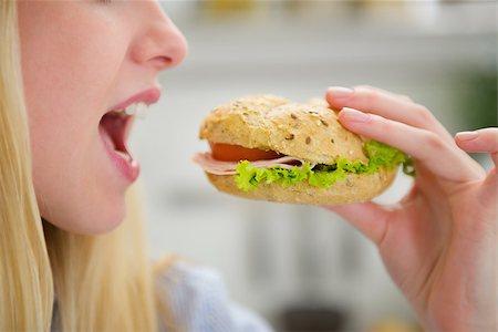 Closeup on teenager girl eating burger Stock Photo - Budget Royalty-Free & Subscription, Code: 400-06853552