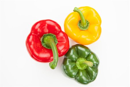 Red green and yellow peppers on white background Stock Photo - Budget Royalty-Free & Subscription, Code: 400-06864390