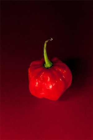 Red scotch bonnet chili pepper on red and black background Stock Photo - Budget Royalty-Free & Subscription, Code: 400-06864392