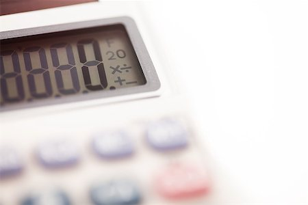 Calculator close up on white background Stock Photo - Budget Royalty-Free & Subscription, Code: 400-06864425