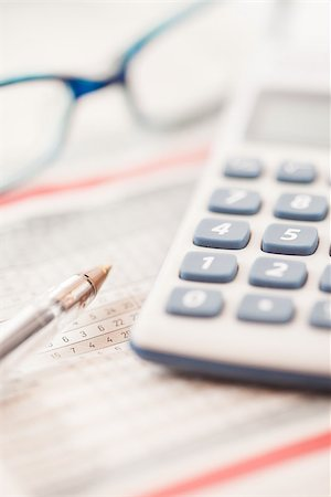Calculator and maths tables with pen and glasses Stock Photo - Budget Royalty-Free & Subscription, Code: 400-06864428