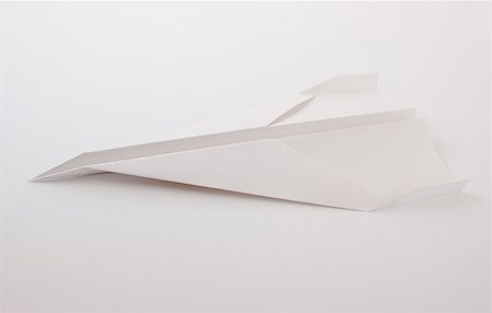 Paper plane on white background Stock Photo - Budget Royalty-Free & Subscription, Code: 400-06864422