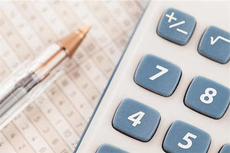 Sector of calculator and biro on maths tables Stock Photo - Budget Royalty-Free & Subscription, Code: 400-06864434