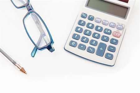 Pen calculator and glasses on white background Stock Photo - Budget Royalty-Free & Subscription, Code: 400-06864435
